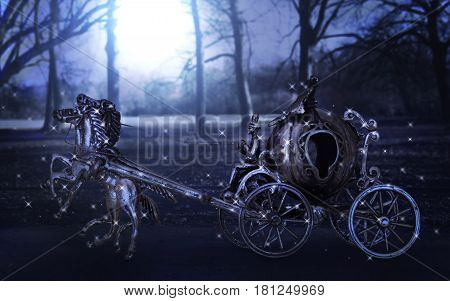 Magical carriage pulled by horses in a park at night in the moonlight.