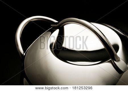 part of steel pot stilllife lighting on the black background