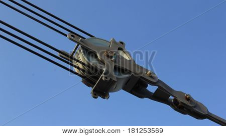industrial steel pulley on the blue sky
