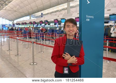 HONG KONG - CIRCA NOVEMBER, 2016: indoor portrait of a woman at Hong Kong International Airport. It is the main airport in Hong Kong. The airport is located on the island of Chek Lap Kok