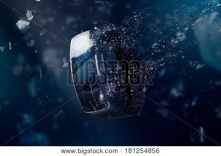 The smartwatch is disintegrating in space. Conception of passage of time and obsolete technology