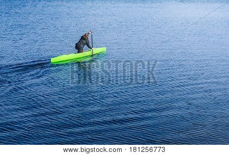 Woman paddling with canoe on the blue river on a sunny day. Young women canoeing. Kayak. People kayaking in the river Dnieper. Activities on the water. The concept of a way of life. The concept of overcoming obstacles.