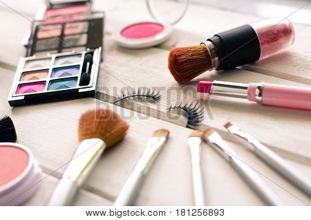 Cosmetics for women on the white wooden floor