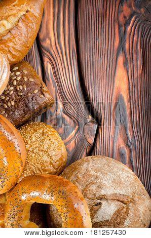 An assortment of bakery fresh breads. Sourdough, bun, challah, bagel.