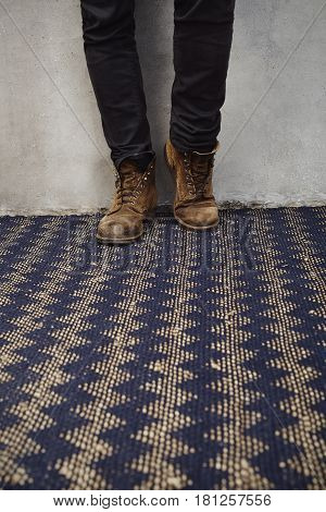 Old boots and jeans on zig zag rug