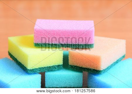 Colorful sponge for cleaning ware and house cleaning. Cleaning sponge with scrub set. Closeup