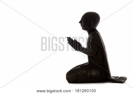 Zen Master practicing mindfulness and reaching Enlightenment. Buddhist monk in meditation. Figure isolated against white background with copy space.