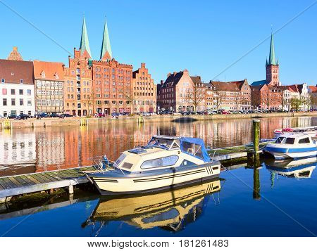 Boats And Historic Buildings At Trave River, Old Town Of Lubeck