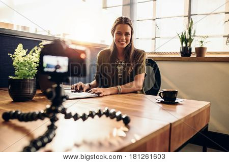 Young Female Vlogger Recording Content For Her Video Blog.