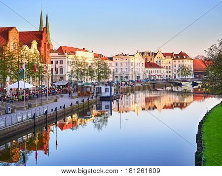 Lubeck, Germany - April 9, 2017: Historic Buildings Reflected In Trave River, Old Town