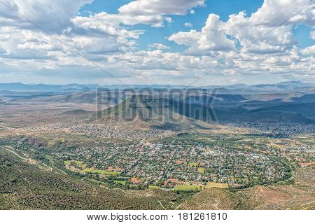 An aerial view of Graaff Reinet as seen from the toposcope near the Valley of Desolation viewpoint. The town lies in a horseshoe bend of the Sundays River