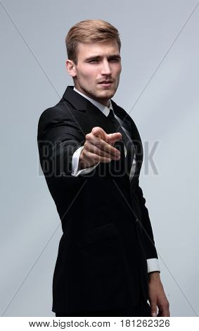 Portrait of a successful  business man showing his index finger