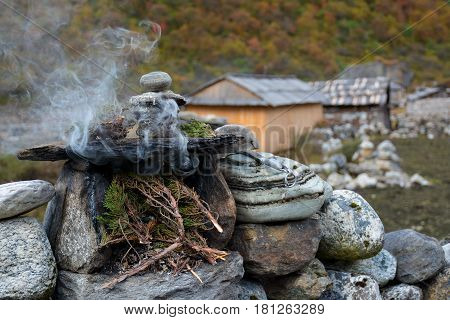 Burning juniper twigs - tibetian ritual tribute to the spirits for protection and good luck.