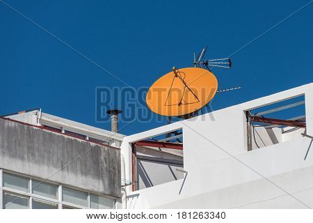 image of satellite dish on the house