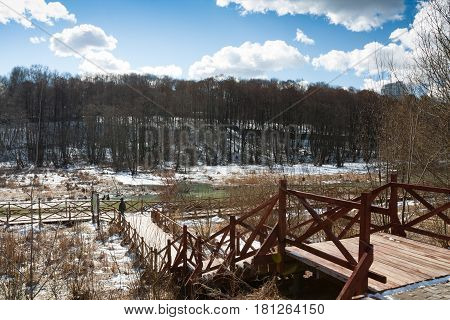 Wooden Staircase Descending To Coast River In Moscow Park Russia. Spring Sunny Day.