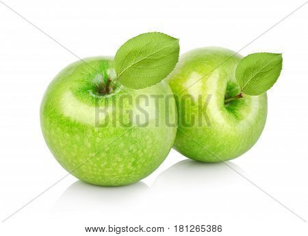 Two green apples with leaves isolated on a white background