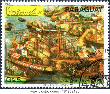 UKRAINE - CIRCA 2017: A postage stamp printed in Paraguai shows The battle of lepanto - 15th century from the series International stamps exhibitions: ship paintings circa 1980