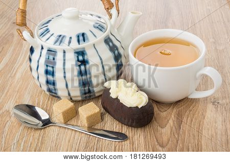 Chocolate Biscuit Cake With Buttercream, Teapot, Tea, Brown Sugar