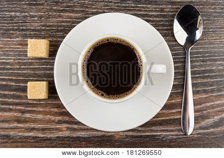 Cup Of Black Coffee On Saucer, Lumpy Sugar And Spoon
