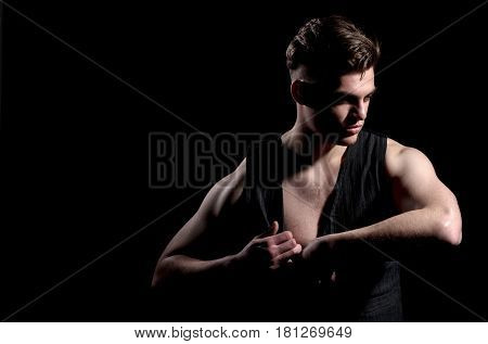 Handsome Man Unbuttoning Vest With Muscular Hands