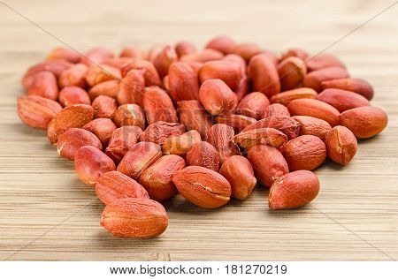 Heap Of Roasted Peanuts On The Wooden Background