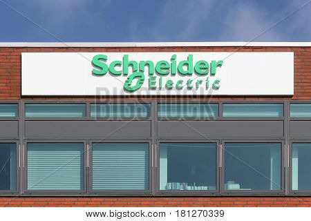 Odense, Denmark - March 9, 2017: Schneider Electric logo on a facade. Schneider Electric is a European multinational corporation, leader in automation and electricity management.