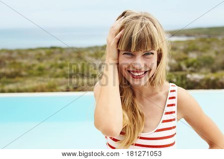 Smiling young woman in striped swimsuit portrait