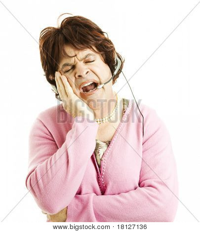 Female impersonator working in phone sales, falling asleep.  Isolated on white.