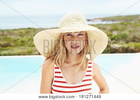 Young woman in swimsuit and sunhat portrait