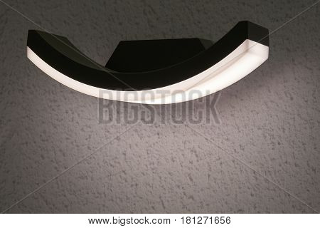 Outdoor electric led lamp mounted on the wall