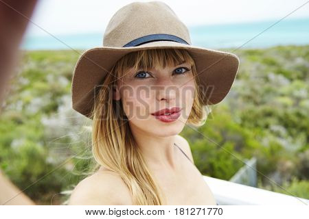 Gorgeous young woman wearing hat for self portrait