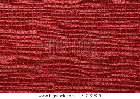 A dark red embossed paper texture background