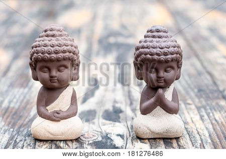 Baby Budda Statues, Teacher or master and apprentice. Two little monks. Meditation and zen, relaxation concept.