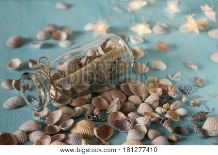 Bottle with a message, seashells. Marine concept. Memories about vacation