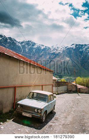 Stepantsminda Gergeti, Georgia - May 23, 2016: Russian Old rusty VAZ-2106 Zhiguli car sedan parking on village street. A hugely popular car, it was in production from 1975 to 2005.