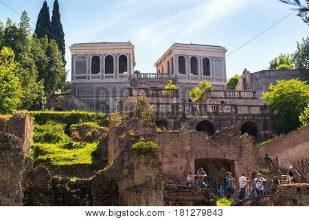 ROME, ITALY - MAY 10, 2014: Tourists visit the Palatine Hill in Rome.