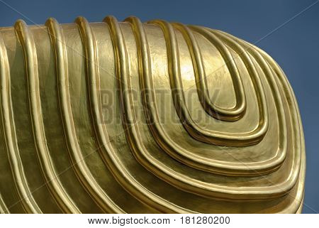 A detail of the shapes on Buddha's knee is highlighted against a blue sky at the Golden Temple religious complext at Dambulla near Kandalarma in Sri Lanka.