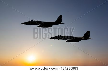 f15 jet fighter on the sunset background