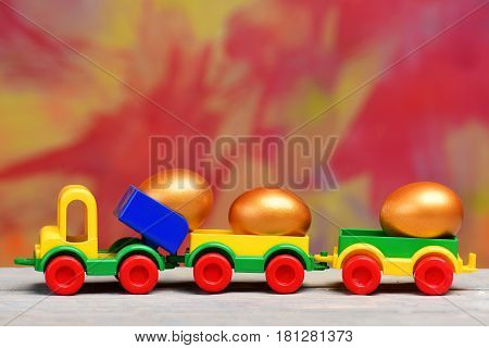 Golden Easter Eggs In Metallic Shell On Lorry Car Toy