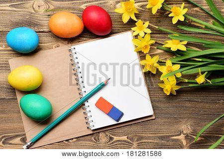 Colorful Eggs, Yellow Narcissus, Notebook, Eraser And Pencil For Drawing