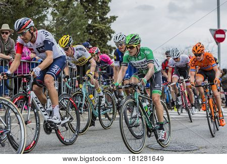 Barcelona Spain - March27 2016: The peloton riding during Volta Ciclista a Catalunya on the road to the top of Montjuic in Bracelona Spain on March 27 2016.