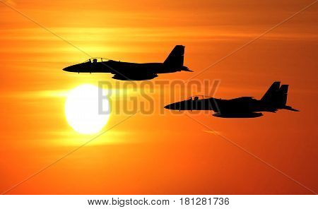 f15 jet fighter on the sun set background