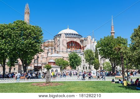 ISTANBUL - MAY 26, 2013: Tourists visiting the Hagia Sophia in Istanbul, Turkey. Hagia Sophia is the greatest monument of Byzantine Culture.