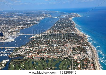 Aerial view of beautiful Palm Beach and Singer Island Florida along with the Atlantic Ocean and the red roof tops of Worth Avenue.