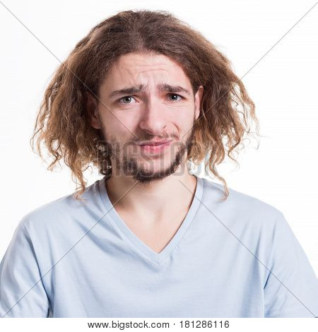 Negative human emotion. Man expressing disgust on face, grimacing on white studio background, cutout
