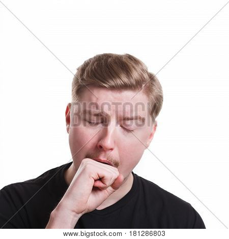 Sleepy yawning man standing on white isolated studio background. Facial expressions