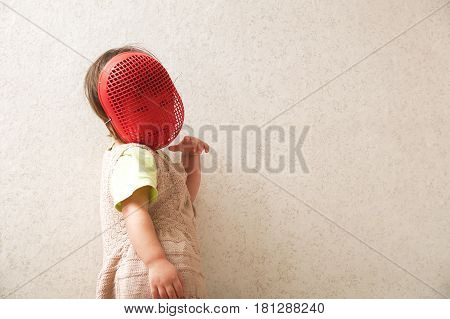 Little girl in fence helmet. Playing artful role in fencing mask. Smiling and happy child playing game. lot of space for text. Cunning persona role. Child play game and having fun