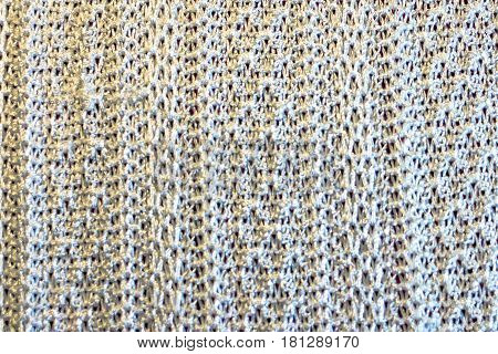 Background of off-white knit material with vertical lines