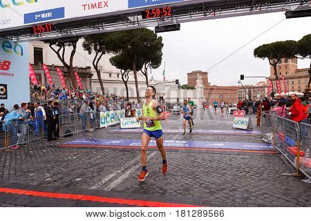 Rome Italy - April 2nd 2017: Athletes participating in the 23rd marathon in Rome arrive exhausted at the finish line on Via dei Fori Imperiali.