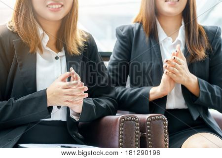 Smile businesswoman clapping hands while sitting concept